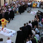 Men dressed as the devil run and spring in the air over the babies laying on mattresses below in Castrillo de Murcia.Photo: Cesar Manso / AFP.