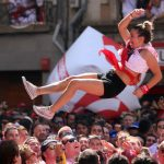 A woman is tossed in the air during the opening ceremony of the San Fermin bullfighting fest  in Pamplona.Photo: Cesar Manso / AFP