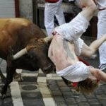 """A Jandilla bull charges at a participant during the first """"encierro"""" (bull-run) of the San Fermin Festival in Pamplona, northern Spain, on July 7th. Photo: Ander Gillenea/AFP"""