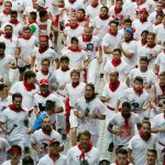 """Participants run during the first """"encierro"""" (bull-run) of the San Fermin Festival in Pamplona, northern Spain, on July 7th. Photo: Cesar Manso/AFP"""