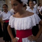 """Dancers get ready to perform during the """"Virgin del Carmen"""" celebrations in Málaga. Photo: Jorge Guerrero/AFP"""
