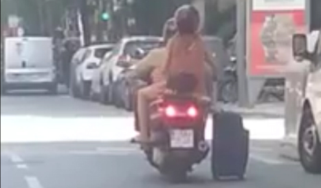 Barcelona scooter pair filmed pulling suitcase