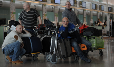 Travellers face delays as train and airport workers strike across Spain
