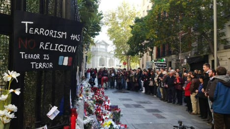 Spain pays tribute to victims of Paris attacks with minute's silence
