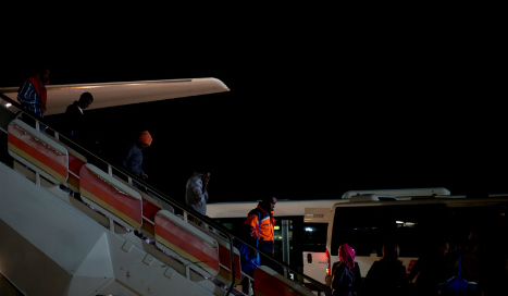 First refugees arrive in Spain under 'desperately slow' relocation plan