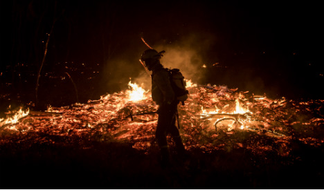 Wildfires rage across northern Spain closing roads and railway