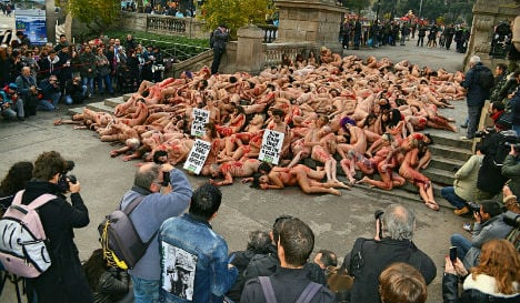 In pics: Protesters strip for 'blood-soaked' anti-leather demo in Spain