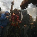 """Correfoc in Catalan means """"fire run"""" and the demons and devils let off fireworks into the onlooking crowd. Photo: Jaime Reina/AFP"""