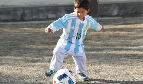 Signed Messi shirt is dream come true for Afghan boy