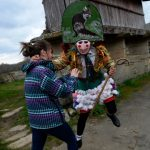 """<b>Maceda, Galicia.</b> A villager dressed as a """"Felo"""" jokes with a woman during the traditional and ancestral carnival.The Felos are the """"authority"""" during the week of Carnival, meaning they can break the rules. The mask represents virility. Photo: Miguel Riopa/AFP."""