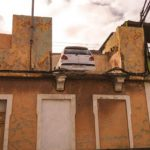 Police baffled by car parked on top of house in Spain