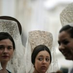 Women wearing the traditional mantilla, or Spanish lace shawl. Photo: Cristina Quicler/AFP