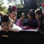"""Girls dressed in the traditional """"flamenca"""" costumes. Photo: Cristina Quicler/AFP"""