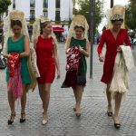 """Women wearing the traditional """"mantilla"""" (a lace shawl). Photo: Cristina Quicler/AFP"""