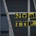 Activists scale skyscraper in Spain to protest US trade deal