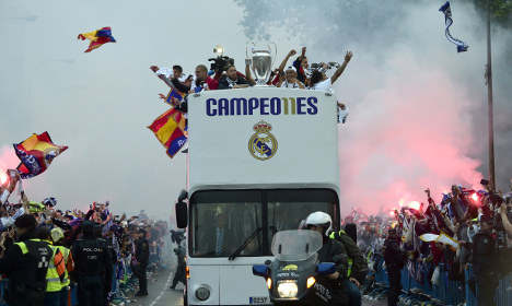 Real Madrid come home to ecstatic crowds in capital