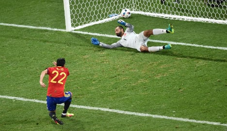 Spain wins place in knockout round after routing Turkey 3-0