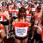 Topless protesters get bloody over Pamplona bull run