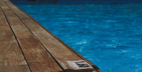 Man found dead in swimming pool tied to bag of stones