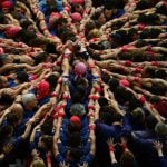 The strongest and heaviest members of the team interlock their arms at the bottom.Photo: Lluis Gene / AFP