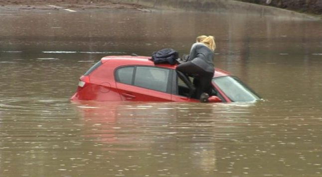 Watch: Dramatic escape of motorist from flooded car in Spain