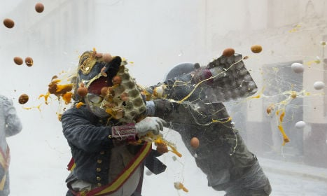 Ready, aim…flour! Spanish town stages mock battle with eggs and flour