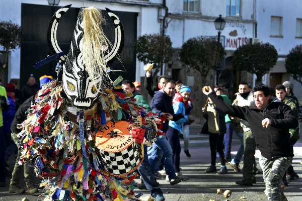 IN PICS: Is this Spain's weirdest fiesta? Villagers pelt 'devil' with turnips to drive away evil
