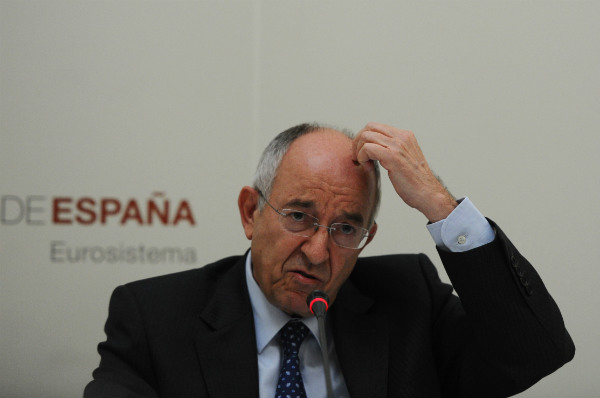 Ex-governor of Bank of Spain charged over banking scandal