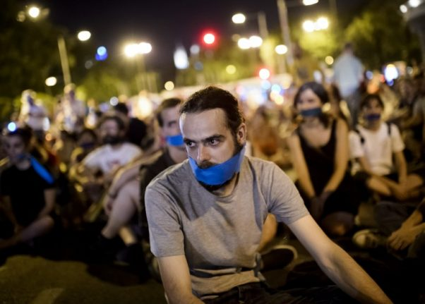 Woman gets jail term for tweets as critics worry about free speech in Spain