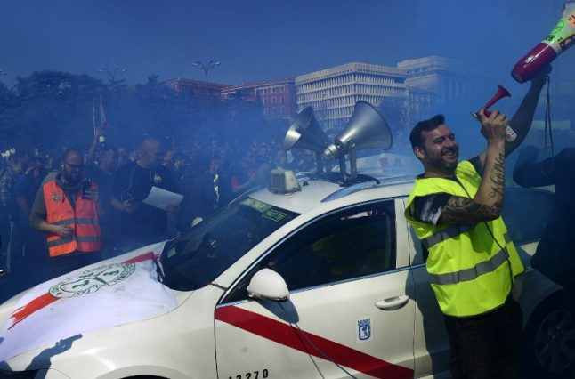 Spain's taxi drivers strike over Uber and Cabify