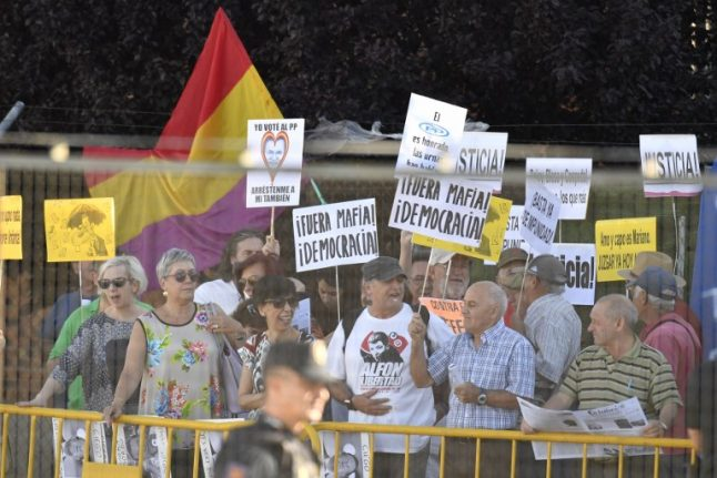 Protests outside court as Spanish PM takes stand in corruption trial