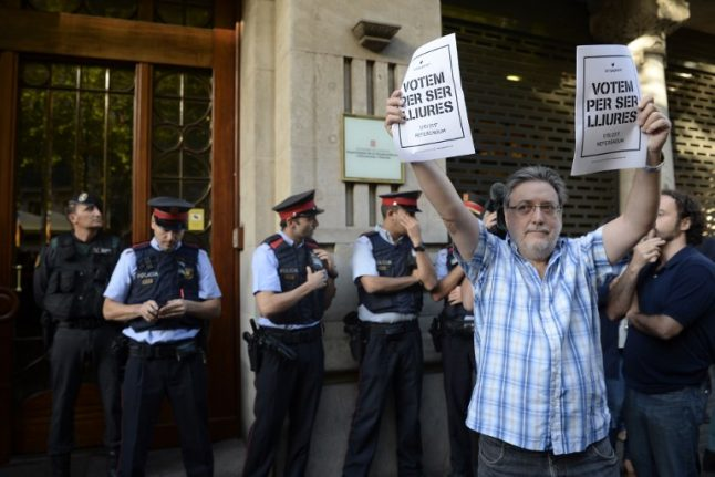 Spain police search Catalan govt headquarters amid referendum row