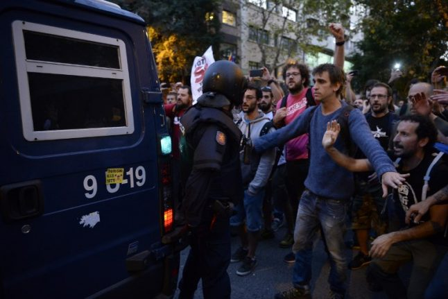 Catalans rally into the night after major escalation of tensions with Madrid