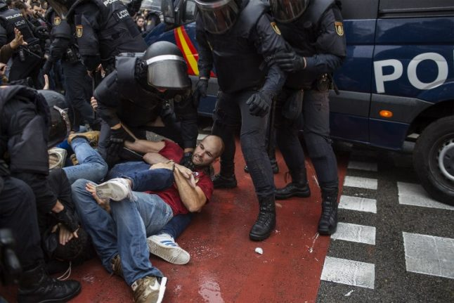 Spain government representative apologises for Catalan vote injuries