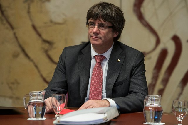 Calling election in Catalonia wouldn't put Puigdemont in the clear, Spain's justice minister warns