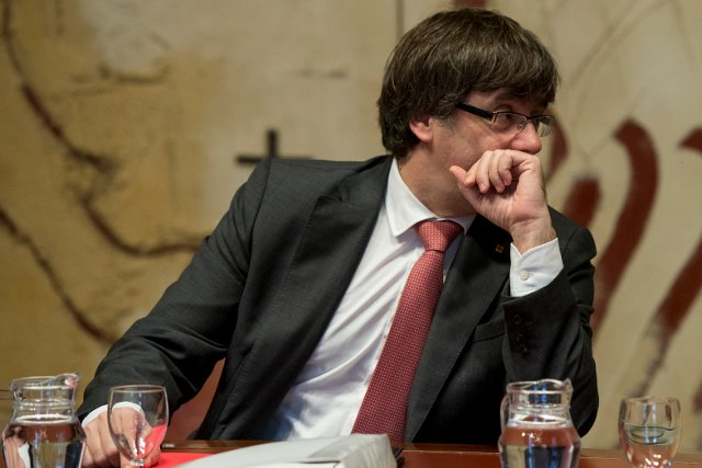 Confusion as Catalan president calls press conference, delays, then suspends it