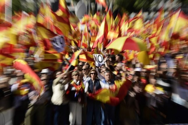 Thousands rally in Madrid, urge jailing of deposed Catalan leader