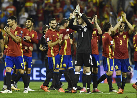 Catalonia cloud lingers as Spain shine on road to Russia
