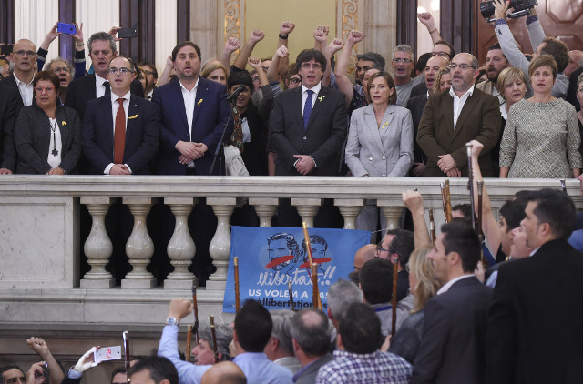 Puigdemont urges supporters to remain peaceful after independence declaration