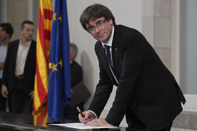 Allies press Puigdemont to lift suspension on independence declaration