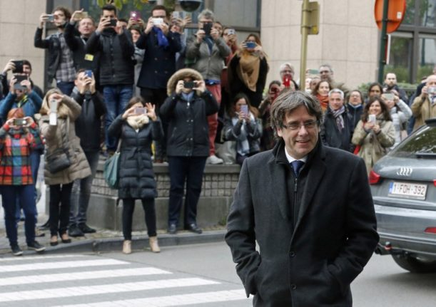 Puigdemont turns himself in to Belgian police