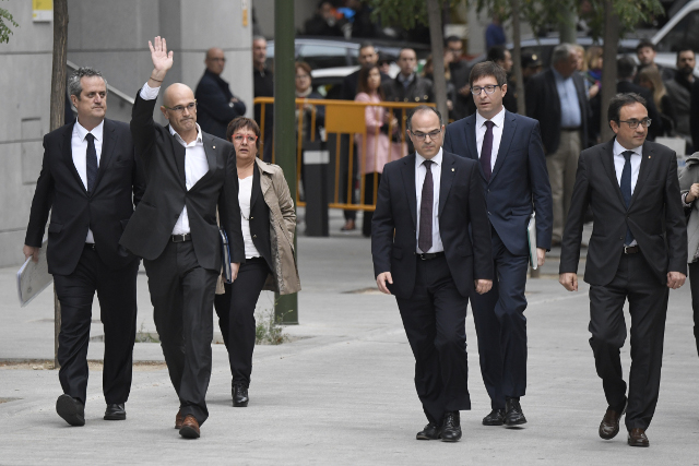 'The more fuel you pour on the fire, the bigger it gets': Catalan separatist leaders arrive for questioning in Madrid