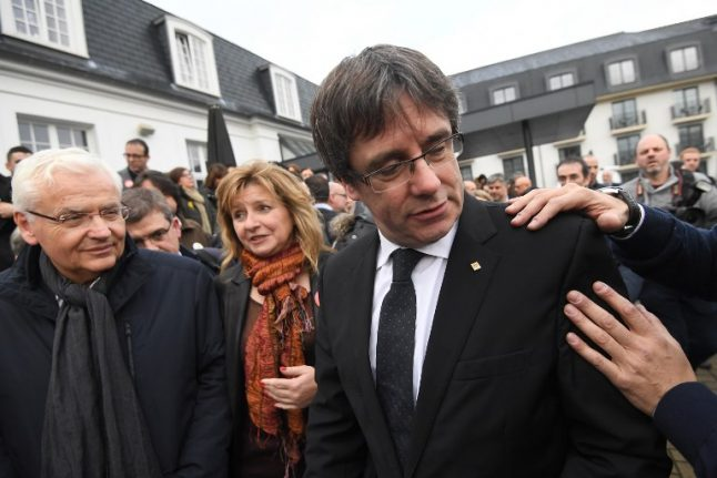 Catalonia's ex-leader Puigdemont says he's not in any hurry to leave Belgium