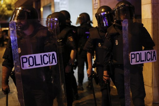 Spain pulls police reinforcements from Catalonia