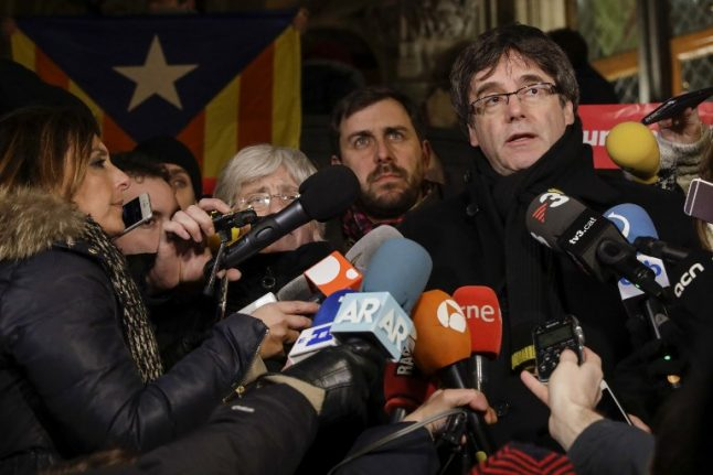 Puigdemont's party seeks law change to allow rule from Belgium