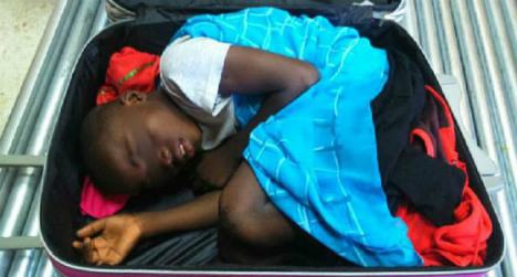 Father of suitcase boy walks free as family reunited