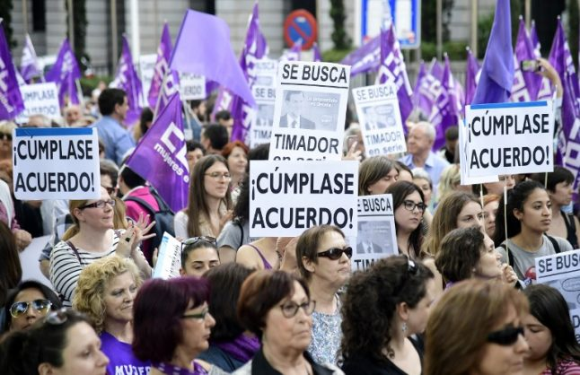Women take to the streets in Spain demanding funds to fight domestic violence
