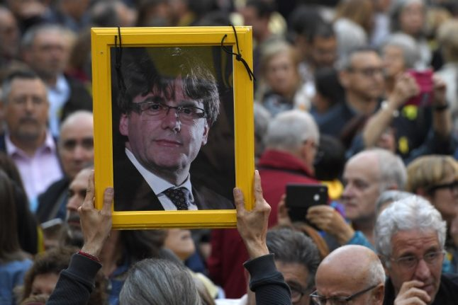 Catalan parliament defies Spain and changes law that could make Puigdemont president
