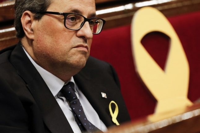 Catalan president forms govt without jailed or exiled ministers
