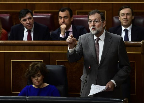 Embattled Spanish PM rules out quitting over graft case